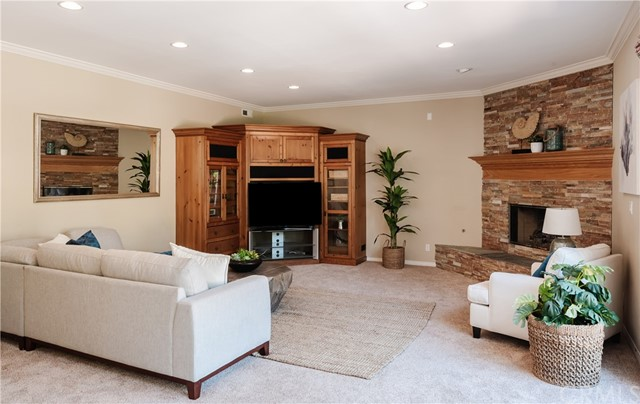 Fabulous entertaining Family Room, built-in entertainment cabinetry and awesome ledge stone fireplace.