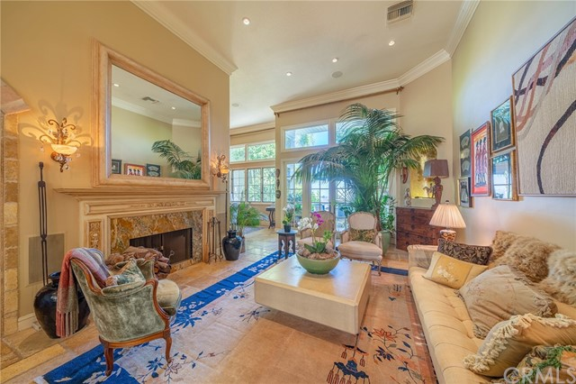 Highly Customized 3-Level Home in Brentwood reminiscent of a French Chateau with Gorgeous 180 views of the mountains, Golf Course and Downtown LA in the exclusive gated community of Mountaingate.  Superb for indoor/outdoor entertaining, with upper balcony showcasing stunning Vistas, and beautifully landscaped lower patio in backyard, featuring a spa w/waterfall in a very private setting. 18 foot ceilings in entry and Livingroom, stone mural and custom cabinetry in kitchen, French windows and doors throughout let in lots of light. 3 fireplaces, including one in the Master Suite and one in the adjoining sitting room/office for a cozy atmosphere. Each Master Suite and  attached bath are on different floors for complete privacy. Spa bathroom downstairs features Steam Shower and 2 person Jacuzzi Tub. Tiered zones for music and heating/AC so custom settings can be made on each floor. Guard-gated community with 24/7 roving Patrols and Golf/Tennis memberships are available. Stunning Primary Residence or perfect for Bi-costal Executive needing an Exclusive Pied a Terre.
