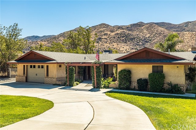 CUSTOM BUILT 3 BEDROOM 2 BATH RANCH HOME ON PRIME HORSE PROPERTY. This home sits on an acre of land right against the gorgeous Mt. San Jacinto mountains. Upon entering you will be greeted with an open living and kitchen area. The kitchen has been updated with gorgeous quartz counter tops, recessed lighting, freshly painted white kitchen cabinets and a deep stainless steel sink and faucet. You will also, find beautiful wood-look plank tile flooring throughout the main living spaces. Step out back onto a huge covered patio with 2 ceiling fans and a relaxing spa to sink into at the end of the day. There is a fully fenced corral, fully fenced open pasture and a fenced dog run on side of house. You will also find an enclosed carport that is plumbed for sewer with a lean to attached which affords lots of extra storage space. RV parking is an extra bonus.