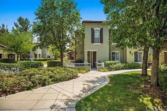 This immaculate home is located in the prestigious Village Walk community in Valencia Northpark.ThePrivate Corner/End Unit is perfect for entertaining! It has a large wrap around patio and is adjacent to the pristine pool area.  The floorplan is ideal with a large open first floor dining room, family room and kitchen. Wood floors,built-ins, crown molding, and2-car garage attached directly to the unit.At over 1,600 square feet with 3 spacious bedrooms this one will not last!