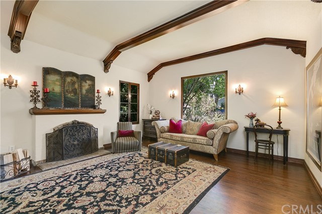 Living Room with Picture Window and Wall Sconces