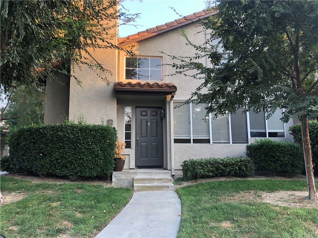 Located in the gated community of Windflower within minutes to Aliso Viejo's Town Center to shopping, theatre and restaurants.  Private gated community is this well located end unit three bedroom, 3 bath. One bedroom downstairs with access to full bath.  Two bedrooms upstairs with private baths and great closet space.  Open kitchen and dining room to the living room with fireplace. Easy care wood laminate flooring with tiile in kitchen and baths.  Enjoy open views looking through the large atrium windows to the greenbelt.  Easy direct access from your over sizeed, side by side garage into the unit. It includes a full size washer and dryer located in the garage and kitchen includes a stainless refrigerator.  Plenty of parking for guests.   Windflower community HOA includes a pool/spa, barbeque area and playground.