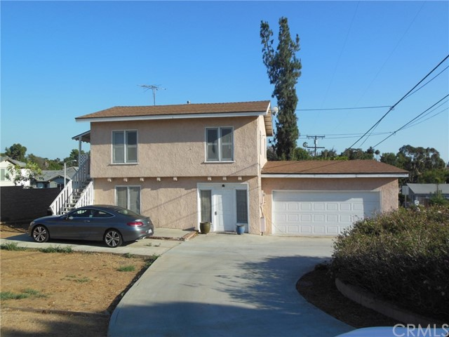 This is a 3 bed 1 bath home with central air,  a 2 car garage and a full laundry room. Large lot. It does have a 1 bed guest house on the 2nd floor that someone lives in. Located in a great area just across from the Nixon Library. Large yard area.