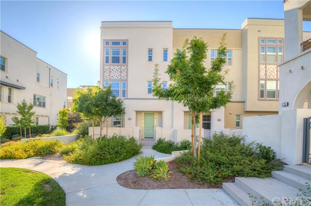 Welcome Home to 118 Acamar in the Prestigious City of Irvine! Prime End Unit Location in the Rowland Collection of Great Park!! This Stunning Modern Home by Lennar Homes has over $65K in custom upgrades! One of a kind tri-level floor plan, 3 Bedrooms w/ensuite bathrooms, boasting 1,939 sq ft of abundant living space! Main floor w/1bed & ensuite full bath, direct access to 2 car garage w/electric car charging! Make way upstairs, you'll fall in love w/the large open floor plan, it's light n bright! Gorgeous wood flooring sweeps thru out, high ceilings & recessed lighting! Huge great room, opens up to dining space w/modern light fixtures. Elegantly remodeled kitchen w/quartz countertop, subway tile backsplash, white shaker cabinets, GE profile S/S appliances & walk-in pantry. Nicely sized balcony w/removable screen. Plus, 1/2 bath for guests. On the Top floor, Main master suite w/11 ft ceiling, walk-in closet & en-suite full bath w/barn door, dual sinks & walk-in shower. Third bedroom w/walk-in closet & en-suite full bath! Convenient laundry room w/utility sink. On top of it all Bonus Features inc; Gorgeous hardwood flooring, Fully remodeled kitchen, Remodeled bathrooms w/quartz countertop, marble style ceramic tile flooring, Plantation window shutter, Tankless water heater & More! Located w/in walking distance to Beacon Park School (K-8), Resort Style Amenities (Ask for Details), shopping, dining, entertainment & easy fwy commute. Don't miss this once in a lifetime opportunity!