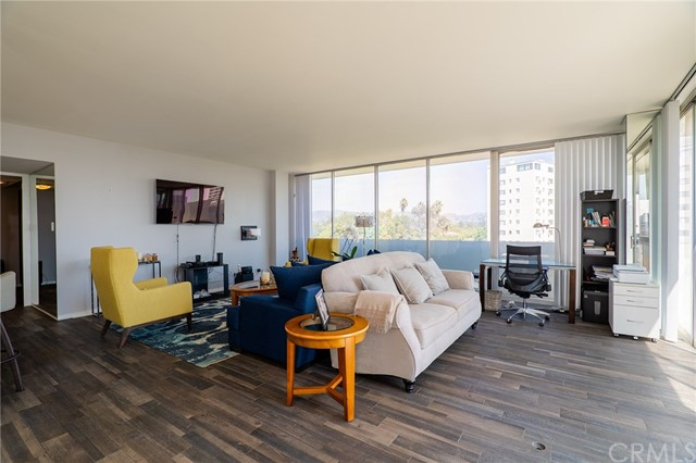 This beautiful corner unit, condominium home has been extensively upgraded to an open, modern design. It has been finished with porcelain tile floors, a remodeled kitchen with stainless steel appliances, ample closet space, and amazing views. The living room boasts floor to ceiling windows with a wrap around balcony showcasing mountain views of Holmby Hills and city views of the Wilshire Corridor and Century City. The Wilshire Holmby is a full service building with 24/7 valet, doorman, concierge service, accessed entry, pool, exercise room, recreation room and communal laundry. Take a look at this beautiful, spacious condo that is right in the heart of the city.
