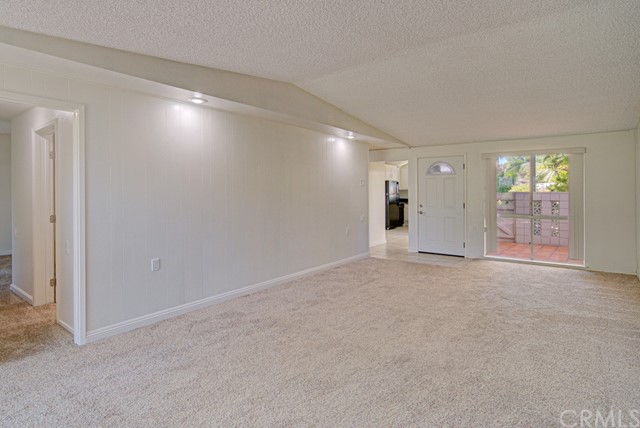 Another view of the living room. Hallway at far left leads to master bedroom. Kitchen can be seen in distance at center.