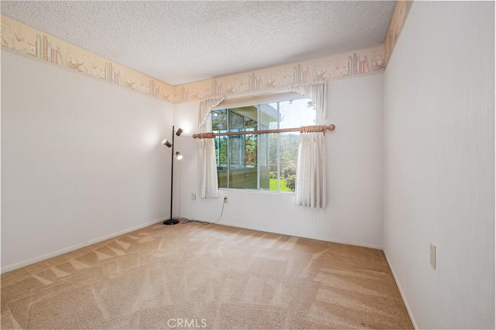 Second Bedroom with Fan & Mirrored Closet Doors