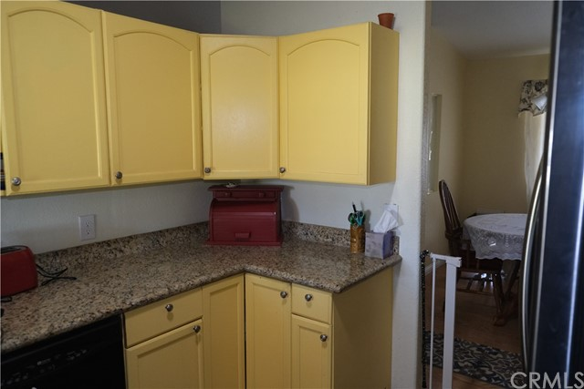 Granite Countertops and extra storage added.