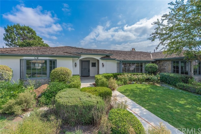 Great opportunity to own 2 houses on a 20.000+ sq ft lot in a perfectly manicured quiet residential street. Main house is a single story home with 4 bedrooms/3.5 baths, 4200 sq ft and a detached guest house with 1 bed/1 bath, 1015 sq ft with private access. Main house features large great room, formal living room, spacious kitchen with pantry and formal dining room. Master suite is extremely enjoyable and private with fireplace, large walk in closet and french doors opening to the backyard. Guest house has an open floor plan with vaulted ceiling, full kitchen, good size bedroom, 3/4 baths and washer/dryer hook ups. 3 cars garage with epoxy floors and designated laundry room with ample locked storage space.