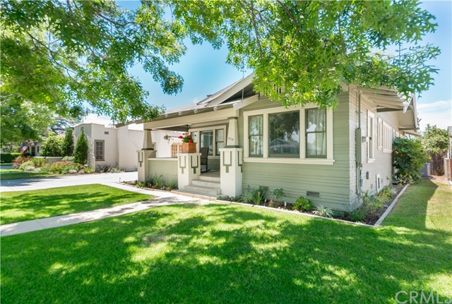 Own a piece of history with this 1920's Craftsman. It is a true Old Towne Orange Historic District gem. Complete with three large bedrooms, a spacious bathroom and three over sized garages. Two garages are located in the backyard and have been used to house classic cars, a separate photography studio and right next to the studio, is a fully finished , air conditioned, bonus room. The third garage is found at the end of a long driveway, where you can park multiple cars or your RV for cross country trips. The backyard is big enough for kid's imagination to run wild and has a mature shade tree. The front entry porch is the perfect place to unwind and enjoy Old Towne. Don't miss out on this rare find.  When you enter the home you are greeted by original hardwood flooring in the spacious living room, complete with fireplace, which basks in warm ambient light. Next, you will be delighted by the formal dining room with a built in China hutch. The historic carriage room is currently used as a reading room. The kitchen is complete with farmhouse sink, stainless steel appliances, a 6 burner Viking cook top and finished with a breakfast nook. You will then find well apportioned bedrooms, which are serviced by the main bath, adorned with wainscoting and custom ceramic tile.  The home truly combines location, charm and character. Just blocks away from restaurants and shops at the Orange Circle and the Chapman University Campus.