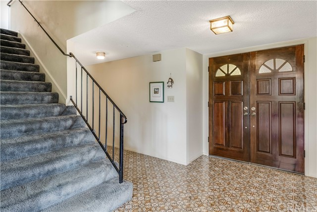 Foyer and stairs leading to second level