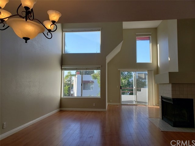 Charming upper-unit condo.  Light & Spacious with Cathedral Ceiling.  Large living room with Fire place.  Hardwood floor throughout.  Granite counter top.  One detached garage plus 2 parking space with permits.  Walking distance to Saddleback College.  Close to Freeway and Mission Viejo Mall.  Washer, Dryer and Refrigerator are included, so just bring your clothes and move in.  Must see!