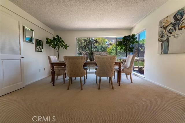 Dining Area off living room; enter kitchen thru doorway to left.