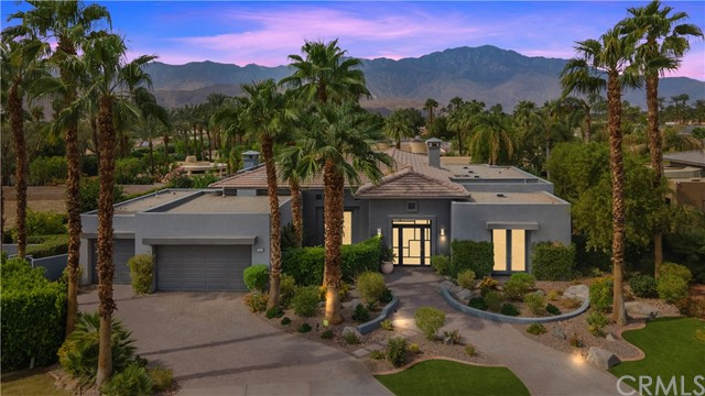 Welcome to your own private desert resort located in the gated community of Artisan. You first enter into the great room with floor to ceiling windows and electric shades. Beautiful remodeled gourmet kitchen that features quartz countertops, stainless appliances and countertop seating. A master suite with French doors and custom built-in cabinets. The master bathroom includes double sinks, soaking tub, walk-in shower and oversized walk-in closet. This home has an additional 2 guest bedroom suites, each with ensuite bathrooms. You then step outside to an outdoor covered living area with built-in BBQ, fireplace, pool/spa with waterfall, putting green and beautiful views. This gorgeous home has everything you need and did I mention it is solar equipped?!