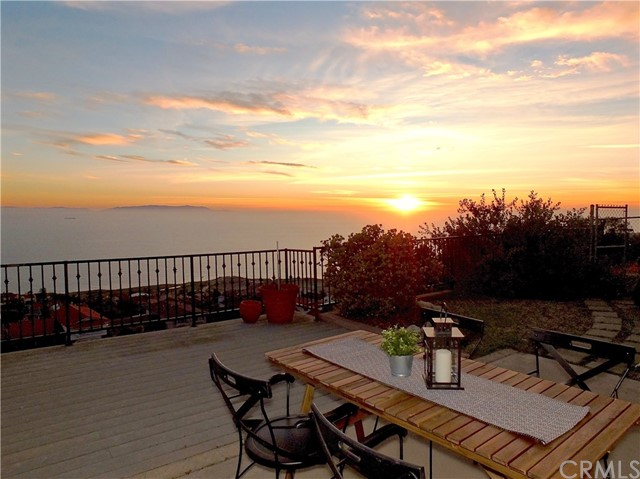Spacious 5-bedroom home in the coveted Mira Catalina neighborhood of Rancho Palos Verdes with 180 degree views of the ocean and Catalina Island. This single story, 1964 home still has many original finishes.  The double door entry opens into the foyer with magnificent views of the water through the spacious dining and family rooms. Separate living room just off the entry features a brick fireplace, large corner windows and built-ins.   The master suite is at the front of the house with a vanity area separating the walk in closet and spacious ensuite with shower.  Four additional bedrooms, two with ocean views, line the hallway. The guest bathroom is centrally located and features dual sinks and separate tub and shower. A utility room just off the kitchen and breakfast nook houses inside laundry, a half bathroom and a door leading out to the refreshing pool along the side of the home. An expansive patio out back offers uninterrupted views of the water and is the perfect spot to watch the sunset and entertain. Large closets and plenty of storage throughout. Short distance to award winning schools, parks and hiking trails as well as golf and resorts.