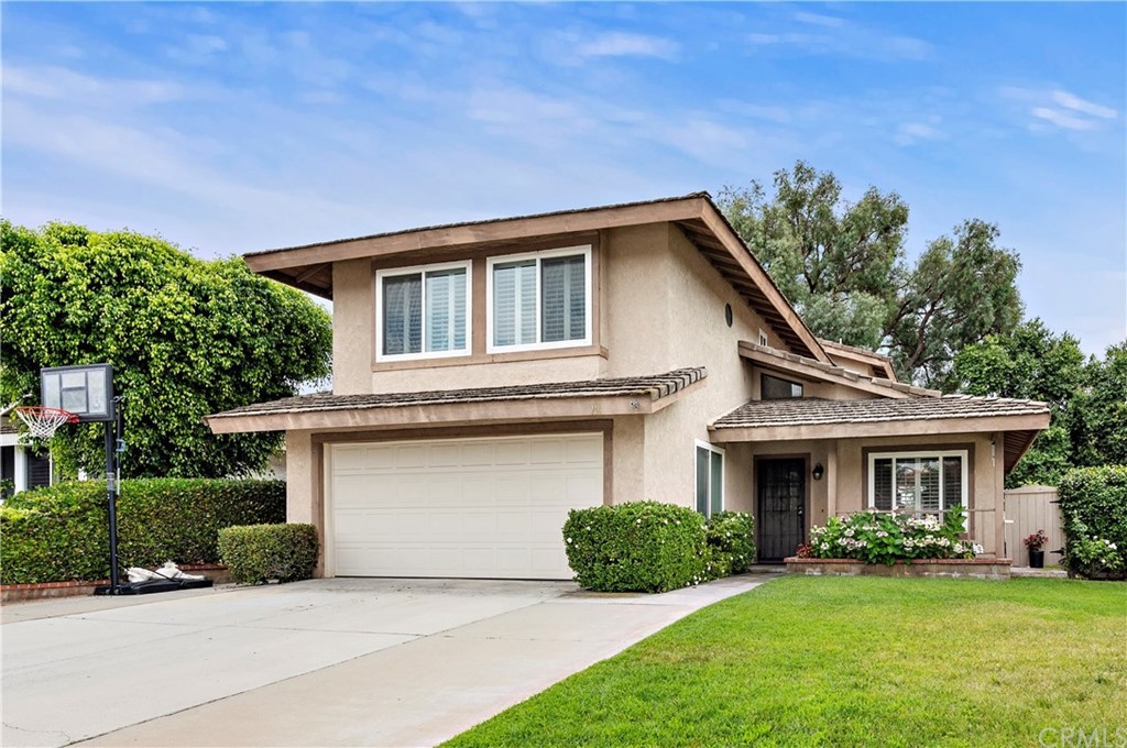 FABULOUS 4 BEDROOM, 3 bath TWO STORY PROPERTY IN BEST CENTRAL RANCHO SANTA MARGARITA LOCATION!! Largest model in the Ranchwood Tract. Quiet interior street in ideal neighborhood. Property shows fantastic with all new kitchen and baths, newer hardwood like vinyl flooring down. All windows have been replaced, ceiling fans in all bedrooms, newer updated interior paint colors. Floor plan features larger living room with fireplace, cathedral ceilings, family room off kitchen, half bath down. New sliders to private rear yard. 4 good size bedrooms all up plus 2 full baths. Property has two side yards the private rear yard with some view over neighbors below. Generous size two car garage with lots of built in storage cabinets and a workbench. Central location makes and easy access to Lake RSM, shopping, restaurants and other amenities.  Enjoy the Lake, pools and parks that RSM has to offer with a low HOA fee and low taxes.  No Mello Roos tax. This a must show to your buyers!