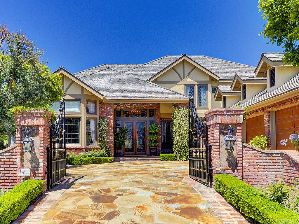 Nellie Gail's finest 7,000 sf, 5 bedroom 6.5 bath cul-de-sac estate fit for royalty. $2,500,000 down-to-the-studs remodel. Sweeping spiral staircase, marble foyer, vaulted ceilings and opulent crystal chandeliers. Intricate woodwork, custom wool carpet and hand-cut stonework. Spacious gourmet kitchen with dual Sub-Zeros, wine refrigerator, stainless appliances and built-in Miele cappuccino maker. Formal dining room with textile-finished walls and framed woodworking. Finished coffered ceilings, remote-control drapes, his and her spacious walk-in closets and custom cabinetry. Master balcony with view of lush yard, pool and park. Four huge ornate fireplaces. Wet bar with oversized wine refrigerator, sink and ice-maker. Finished and climate controlled third floor (non-permitted) and a spacious walk-in storage attic. Executive hardwood office with rich cabinetry. Granny flat with full bath and two separate entrances. 6-zone multi-split heating and cooling system with hospital-grade filtration lets rooms be set to different temperatures. Resort-style pool with waterfalls, spa, BBQ, granite bar, covered loggia/gazebo with lights, heater and fireplace. Nellie Gail Ranch offers free summer concerts, Easter Egg Hunts, Winter Snow Days, and a clubhouse with tennis courts, pools, spa, horse trails and stables. Low HOA dues. Easy access to the toll road and the 5 freeway. This beautiful fully custom home is also one of the best values in the highly coveted Nellie Gail Ranch.