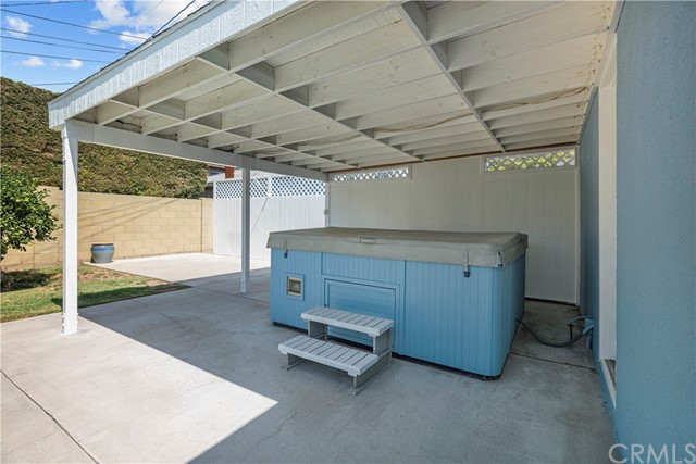 Above ground hot tub with patio cover.