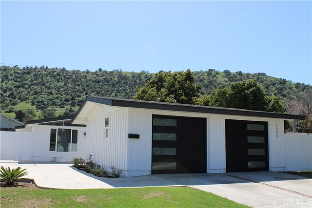 This modern California Ranch designed by Cliff May has been restored to reflect its original charm.  The open floorplan is inviting and brings the outdoors in.  New features include:  roof, cabinets, flooring, paint, windows, doors, appliances, tile, vanities, lighting and garage doors.  Unpack and enjoy.