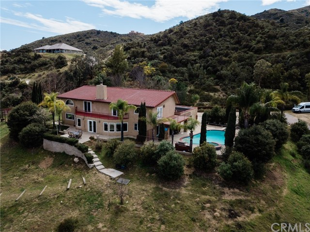 Majestic 4,300 sq-ft horse property with swimming pool on 4 acres . This beautiful home has breathtaking views from all around the property. Welcome all your guests at picturesque grand entry . Home has 5 bedrooms , 3.5 baths plus office and loft. Large Kitchen with high quality granite counter tops with counter bar, huge island, and custom made cabinets. Home comes with stainless steel oven,stove ,and dishwashers .Home offers tall cathedral ceilings, upstairs laundry for convenience, office space upstairs and downstairs. It has one room downstairs and 4 bedrooms upstairs, 3 bedrooms with balcony . Home has large windows though out the home to allow much natural light to enter and to capture natural scenery. Custom made stairs, railings and banisters in wood and iron. The huge lot offers horse stables and riding space below, basketball court , volleyball court , swimming pool and spa. Great home for entertaining family parties or large events .Desirable neighborhood has many trails for riding , hiking and it is very quiet and peaceful. Near fwy shopping , and award wining schools.
