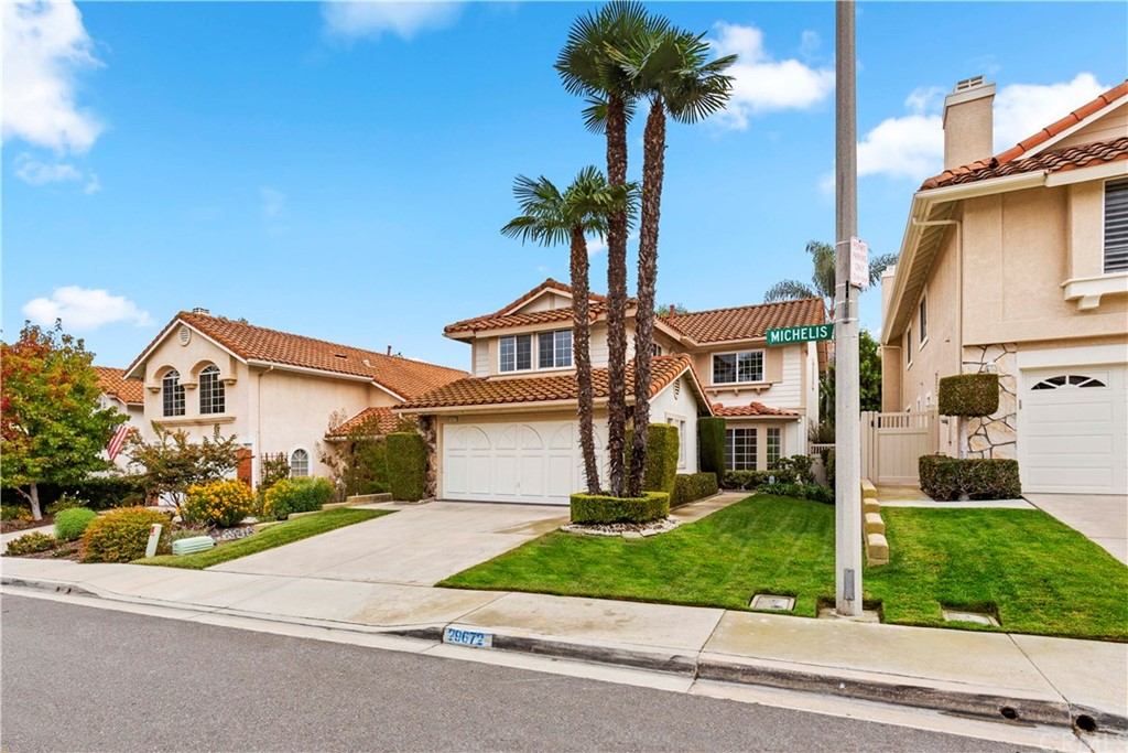 Nestled in the heart of coastal Laguna Niguel, this appx 2283 sqft 3 bedroom, 2.5 bathroom has just been updated with new carpet, new interior paint, including all walls, doors and cabinets, new door hardware and new lighting in Kitchen. Light and bright floorplan with lots of windows for plenty of natural light. Lower level with spacious Living and Dining room, separate family room with cozy stone fireplace and wet bar. Large eat-in kitchen with newly installed recessed LED lighting, coffered ceiling and bay window. Huge master suite with one walk in closet and another closet with mirrored wardrobe doors. Master bathroom dual vanities, separate tub and shower. Oversized secondary bedrooms finish off the upper level. Hall bathroom with dual vanities and tub enclosure. Vinyl windows though out the upper level. Vinyl lower level sliding door. Large private rear yard with fire pit, sitting wall and plenty of space to entertain. Inside laundry, oversized two car garage. Less than 5 miles to the beach! Centrally located to shopping entertainment and the freeways!