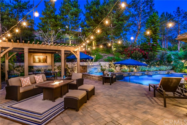 This seductive residence awaits in a desirably tranquil cul-de-sac location. You'll relish the peace of mind you have w/ 24 hr guarded gates for Tustin Ranch. Madrid community within Tustin Ranch has always been most desirable not to mention just across the street from the exclusive Tustin Ranch Golf Course. Drought resistant & professionally landscaped the curb appeal greets you with sleek lush style. The open interior flows uninterrupted &  boasts numerous upgrades throughout. Ultra trendy, modern & sophisticated w/ a youthful edge, this functional home has every necessary convenience w/ no detail overlooked. Built-in Thermador appliances, 2 new HVACs, new LED lighting, Ethernet in every room & Lutron RA Radio w/ surround sound speakers. A spacious Master w/ Retreat is complete w/ an oversized walk-in closet w/ built in organization system. Master Ensuite features a luxurious Roman tub, stone shower & newer countertops. Paradise right outside your back doorstep. A true entertainers dream you & your guests can enjoy the gorgeous Wood Pergola w/ TV hookup, lighting, & anchored hammock posts. Completely redone the resort Pebble-tech Saltwater pool & spa w/ water features & custom lighting. Complete of course w/ an outdoor Kitchen, BBQ & bar seating. Never miss another sunset while you savor the quintessential Southern California views. This house screams 'designer' & will reflect the personality & taste of those accustomed to the best in quality design, finishes & lifestyle.