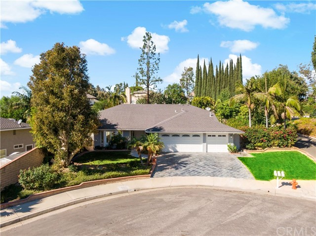 ***GORGEOUS SINGLE LEVEL HOME ON A TREE LINED STREET IN THE HILLS OF ORANGE*** Fantastic Location At The Top Of The Hill On A Private Cul-De-Sac*Beautifully Remodeled W/ A Most Desirable Open Concept Floor Plan*Inviting Formal Entry W/ Travertine Flooring* Impressive Formal Living Room With High Ceilings and Exquisite Dining Room Offering Wonderful Sunset Views***Extraordinary Extended Kitchen Features Stunning White Cabinetry & Striking Black Granite Countertops and Backsplash*** HUGE Center Island Offers An Abundance Of Preparation Space & Seating,  Stainless Steel Appliances  Including A Wine Frig All Perfect For Entertaining***Cozy Family Room Opens To The Kitchen W/ Spectacular Black Granite Fireplace & Sliding Doors All Overlooking The Well Manicured Yard***Spacious Master Bedroom Offers Sliding Doors That Open To An Outdoor Sitting Area**Distinguished Master Bath With White Cabinetry, Granite Counters, Travertine Shower And Jet Tub*Secondary Bath With Gorgeous Custom Walk-In Travertine Shower And Decorative Glass Tile**A Well Sized Second Bedroom With Plantation Shutters***3rd Bedroom/Den Offers A Stunning White Entertainment Center & Sliding Doors That Open to A Large Side Yard Lounge Area*The Back Yard Is Perfect For Outdoor Entertaining Offering A Great Patio With An Extensive Use Of Slate Tile, Spacious Grass Area And Mature Landscaping**The 3rd Car Garage Has Been Converted To A Private Office Space***This Home Has It All & Is In The Villa Park School District!***