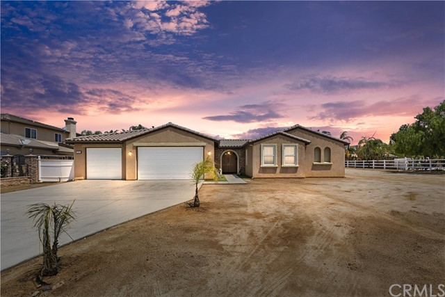 ***GORGEOUS SINGLE STORY ESTATE on OVER 1 ACRE with 4 CAR GARAGE in MOCKINGBIRD CANYON***  This Home's Layout is an Entertainer's Dream with an open concept floorplan, Interior Courtyard with Outdoor Fireplace, 4 Bedrooms, Office (could be 5th Bedroom) 3 1/2 Baths, 3385 Sq. Ft, 1.02 Acres and 4 Car Tandem Garage.  You will absolutely Love this Layout with tons of room for a large Family and In-Laws/Guests with lots of upgrades including Natural Stone throughout, NEW Interior Paint, NEW Carpet and NEW Double Oven!!!  The Formal Living Room and Dining Room have access to the Kitchen and overlooks the Courtyard with a Fireplace.  The spacious Kitchen has a Huge Island, Granite Countertops, Upgraded Cabinetry, Stainless Steel Appliances with a NEW Double Oven (GE Cafe Wifi $4500), separate Coffee Bar and Pantry.  The Kitchen overlooks the Huge Family Room with Fireplace, Massive Backyard and Courtyard.  The Master Bedroom has a Fireplace, overlooking the Backyard with a Huge Master Bathroom, Walk-in Shower, Double Sinks, Separate Vanity and two Separate Walk-In Closets.  There are 2 additional bedrooms with an adjoining bathroom and another Bedroom (4th) with private Bath perfect for In-laws or Guests providing lots of privacy.  The Backyard is Huge with tons of space to build a Pool, Spa, Horse Facilities and Separate Guest House.  The front yard has been