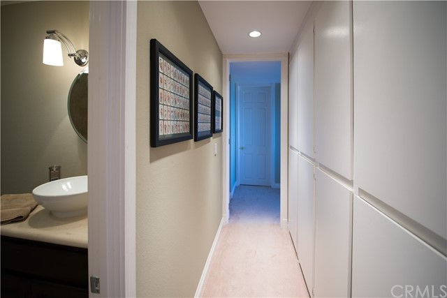 Bedroom hallway with linen closets and guest bath appearing on the left
