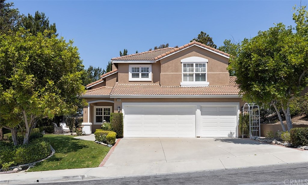 A BEAUTIFUL, UPGRADED 4 BEDROOM HOME with a POOL and VIEW in FOOTHILL RANCH, located on one of THE LARGEST LOTS in the neighborhood. This home features an extremely PRIVATE YARD on a corner lot, backed to a green belt, giving you only ONE NEIGHBORING HOME and tremendous views of the mountains, city lights, and ocean! Enjoy your private POOL and HOT TUB with plenty of room to entertain. Located just behind the house is an entrance to WHITING RANCH WILDERNESS PARK with world class hiking and mountain biking. Highlights of this home include the CUSTOM wood trim and accents throughout the house, wainscotting, crown moulding, tall baseboards, vaulted ceilings and a gourmet kitchen with STAINLESS STEEL appliances. Feel at home in the spacious, PRIVATE MASTER SUITE with a spa like master bath, soaking tub and stone floors. This home is truly TURN KEY with NEW windows, carpet, and paint inside and out. Do not miss out on this incredible opportunity to own an updated home in Foothill Ranch with a large lot, pool and a view!  Property Video: https://player.vimeo.com/video/426385994