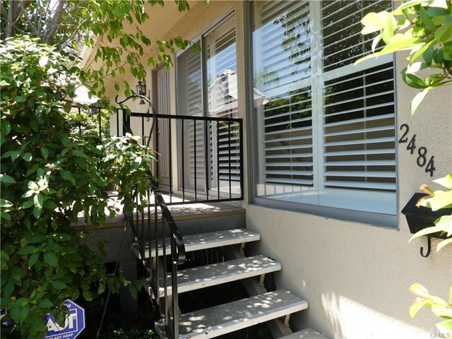 This charming condominium is located in the highly desirable Mountain Park Villas in Pasadena. The residence has been lovingly maintained and shows well.  A welcoming walkway and a few steps up lead to a private front patio deck that opens to an entry, large living room and open dining room. The light and bright kitchen offers white cabinets, Avonite countertops, built-in display shelves, pantry and a dishwasher, stove, microwave and refrigerator. The home features two spacious bedrooms and two bathrooms plus an extra large downstairs bonus room with gas fireplace and three-quarter bathroom.  The master suite has ample closet space and a private bathroom with mirrored vanity, wall sconces and an inviting over-sized shower.  Other features include 1,150 square feet of living space, central air and heat, recessed lighting, plantation shutters, linen and entry closets, and an alarm system. The large two-car attached garage provides secure and direct access to the unit, plenty of extra storage space and a convenient laundry area with washer and dryer. The Association's park-like grounds offer tree-lined pathways and lush gardens leading to an inviting veranda, sparkling swimming pool, spa and two dry saunas. This condo is located in a great neighborhood, and is perfect for comfortable living and elegant entertaining.