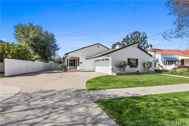 This beautiful and completely remodeled single level home sits on a huge lot located in a charming tree-lined street near Old Town Tustin. Upon arrival you are greeted with fresh landscape, a covered porch and a newly paved extra long driveway suitable for RV(s). The open and bright floor plan features brand new distressed wood-look floors, brick fireplace, recessed lighting, dual pane windows and sliding glass door. The remodeled kitchen opens to the dinning room/family room and boasts brand new shaker cabinets, pantry, quartz counter tops, waterfall island, subway tile backsplash, hooded vent, stainless steel appliances, fireplace/oven and a wall to ceiling brick wall with open shelves. The spacious master bedroom features a walk-in closet with mirrored wardrobe and an ensuite master bathroom that has been completely remodeled. The secondary remodeled bathrooms are equally gorgeous. The huge green backyard is suitable for a pool or perhaps an accessory dwelling (ADU). Enjoy the convenience of a separate inside laundry room with utility sink and lots of storage plus an over-sized 2-car garage with direct access. Almost everything is brand new in kitchen and bathrooms including plumbing, fixtures, hardware and lighting. Other notable renovations include new water heater, new electrical sub panel, new A/C and ducting, new sewer line and plumbing for the laundry room and added half bath (all done with city permits). Conveniently located near FWY, shopping and restaurants.
