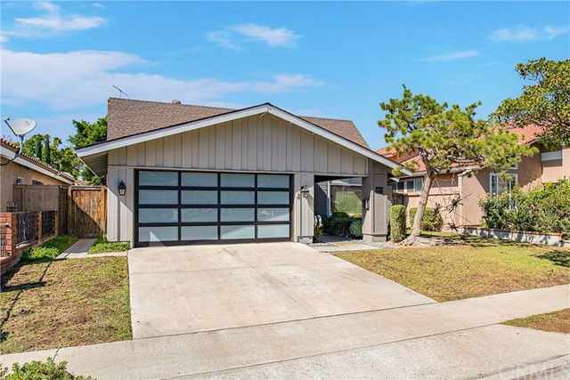 Remodeled Home in Desirable Tustin Meadows. This Modern Home features an Open Floor Plan complete with Main Floor Bedroom, Concrete Tile floors and Vaulted Ceilings. Must see to appreciate!