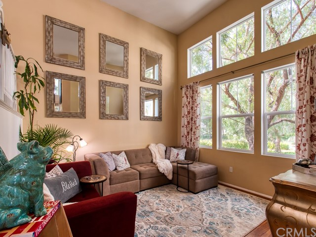 TALL VAULTED CEILINGS-- LIGHT AND BRIGHT with tons of natural light!  Amazing views of the park-like setting-so much privacy being an end unit also!  Plenty of space for entertaining.