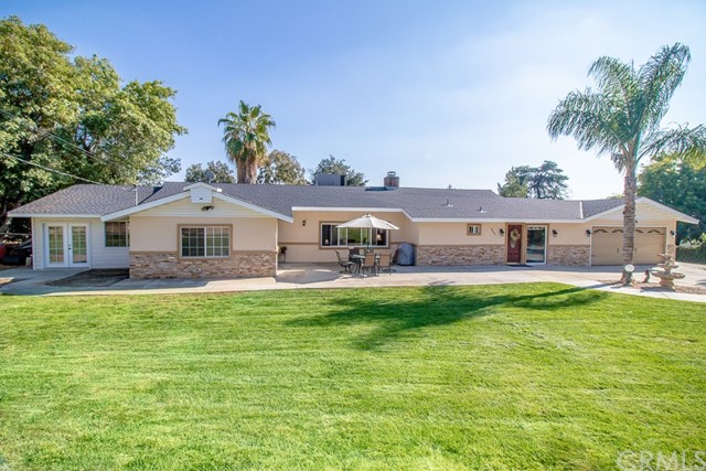 """Gorgeous Cherry Valley single story home spread out over a large private setting. Open concept that is upgraded throughout. Enter into a stunning formal living/dinning area with double sided fireplace that carries on into the very large formal living-room. The kitchen was recently remodeled into a """"Chef's Dream Kitchen,"""" which includes All Top of the Line Stainless Steel KitchenAid Appliances: Double oven, 5 burner stove top, dishwasher, over sized microwave, trash compactor, a wine refrigerator and all new Quartz counters. This stunning addition really adds the Wow..... A Copper Farmhouse apron front sink. Soft close cabinets and pull out drawers add to the touch of detail that is showcased in this home. Also a large family room where you can entertain many. Large bedrooms with ceiling fans and mirrored wardrobe doors. Master bedroom is large with built-in's and 2 sets of french doors, a sitting area and 3 large bathrooms. This home is truly a family retreat... Enjoy relaxing in the yard and eating your own amazing peaches, apples, appricots, plums, cherrys and almonds, from your mature trees! Pleanty of room for your RV, your horses and all of your toys. Just minutes from the famous OAK GLEN ORCHARDS AND FUN!!! No HOA's...Country living at its best.....All additions are permitted."""
