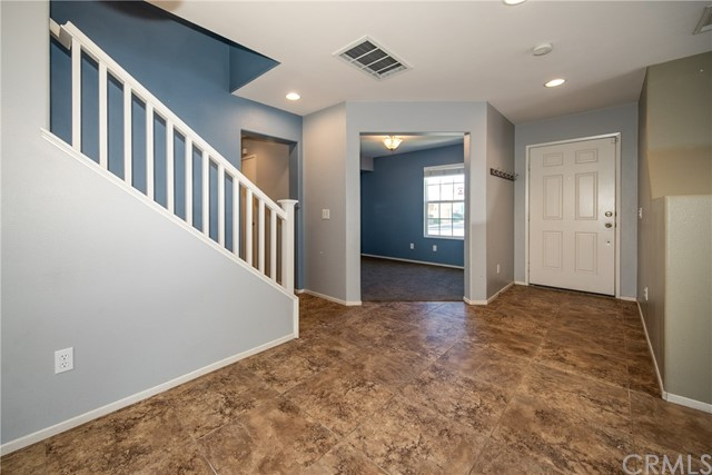 Dining room looking to entry of home