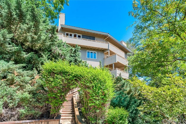 Spectacular View Custom Estate !!! 5 Bedroom, 4.5 Baths, Approx. 4,754 Sq,Ft. Living Area with Approx. 24,000 Sq.Ft. Lot,  Built In 1982 on Skyline Drive in Raymond Hills, Spacious, Bright and Airy Floor Plan, Cathedral - Vaulted High Ceilings, Hard Wood Flooring,  Recessed Lighting, Custom Paint, Custom Window Covering, Base Boarding Throughout, Separated Living Room and Family Room with Fire Place,  Each Bedrooms connected to Wooden Deck w/ Beautiful City Lights, Golf Course, Woods View, Open Gourmet Kitchen w/ Spacious Walk-In Pantry, Granite Counter Tops, Stainless Appliances, Built-In Subzero Refrigerator, Viking Stove with Ventilation Hood, Kitchen Aid Double Ovens, Dish Washer, Compactor, Dumbwaiter, Ceiling Fan in Bedrooms, Master Bedroom w/ Walk-In Closet, Fire Place and Patio with View, New Roof, Entertainment Room with Pool Table, Full Bar, Out Side Deck, and Wine Cellar, 3 Car Garage, and much more!