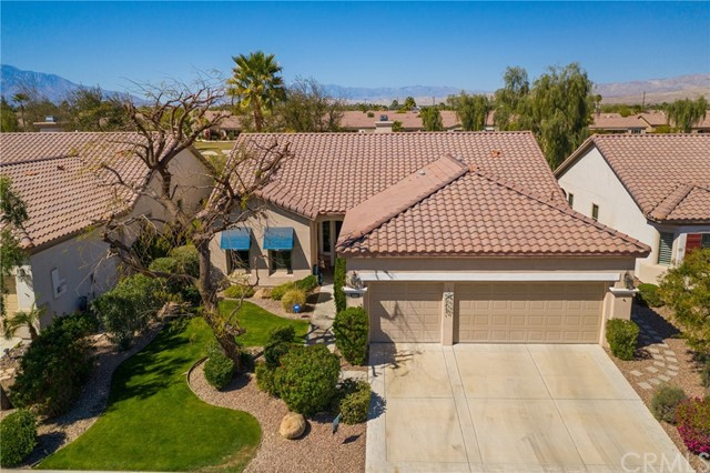 Beautiful San Benito floor plan with Golf Course View & beyond of San Jacinto, San Gregorio & Shadow Mountains. TOUR: https://www.aryeo.com/v2/80342-avenida-santa-alicia-indio-ca-92203-us-679021/unbranded ......Remodeled w/designer features & tranquil outdoor rock fountain, 2 fire bowls, fire pit. Large master bedroom-golf course view, door to patio with Meshtec security screen, custom barn doors open to private remodeled oversized walk-in shower-custom tumbled travertine, new vanities-Cambria travertine, copper double sinks, medicine cabinets, make-up seating, travertine flooring & huge master closet + linen storage. Remodeled guest bath offers designer tile & built in niche. Crown molding throughout, tile flooring except for 2 bedrooms, custom paint throughout, newer window coverings and shutters. The kitchen is every chefs dream with space for everything! Cabinetry has been re-glazed in a rich tone & offers a separate eating space as well as a counter bar for breakfast dining. Adjacent is a formal dining space opened to a great room with glass windows across the back bringing the picturesque surroundings in while you entertain or just relax to the sound of the fountain. Enjoy outside dining under the Alumawood patio cover while listening to the sounds of nature- Garage offers 2 car spaces + golf cart parking, evaporative cooler (installed 2017), epoxy flooring, tons of cabinetry, newer garage door motor, HVAC system upgraded in 2014 to an efficient Hydes system.