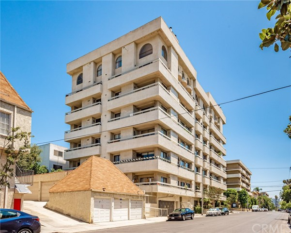 Location, Location, Immaculate one level sleek and remodeled town home corner unit of sunset Bivd. with 2 suite bedrooms and 2.5 Baths, just a few blocks  from Runyon Canyon. Master bedroom has its own South facing balcony and wrap around glass balcony to float natural lights throughout the unit. Open floor plan with gorgeous upgraded wood flooring, Crown molding, Granite Counter tops in the open kitchen with stunning back splash and Center Island, induction cook top hood,Self-closing drawers and pantry. Enjoy large living room with Fireplace, Wet bar, dining area, smooth ceiling, Surround Sound. Beautiful light fixtures, sky lights, custom drapes and window coverings. Mirrored wardrobes, custom closet organizers and Master bath with glass accents shower doors, set of Eco-washer/ dryer and TV in living room and balcony  and refrigerator include in  sale price Amazing Roof -Top Pool/ SPA and spectacular 360 degree View of Los Angeles, Gated, secured 2 Car Garages plus one space for Guest parking. Near -by Ralph's shopping Center. Don't miss it !!!