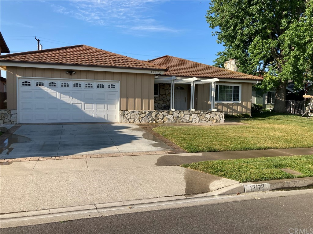 Gigantic back yard, pool size lot with plenty of room left over!  The back yard is huge!  Lots of room to play and host events!  This beautiful home has 4 bedrooms and  2 full baths with upgraded kitchen, counter tops and cooktop with  hard flooring in the dining room, beautiful stone fireplace with mantle.  Charming entry and elevation, this house not only has a two car garage, but a door on the back of the garage and a slab in the back yard so you can pull your boat or trailer through the garage and park it on the slab in the back yard.  Beautiful back yard patio with cover accents this charming home as well as a quaint stone front porch.  This home will not last!  Home is vacant and ready to view.  Buyer to verify all information about this home provided in this listing.  Information is deemed reliable but not guaranteed.