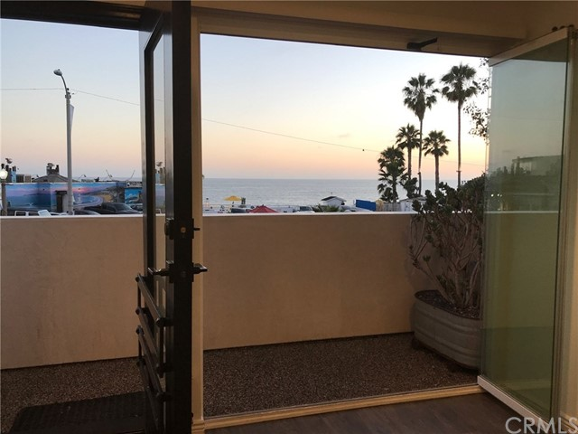 """Ocean View, Executive Grade Remodel, 1BR/1BA, Downtown Laguna Beach, private ground floor apartment featuring an extra wide multi-fold living room patio window for indoor/outdoor living, ocean breeze, and entertaining.  Unit includes a City parking permit.  Come home to your modern 1-story flat to enjoy ocean close living that is walking distance to everything good about Laguna.  A true executive quality unit with luxury finishes and features which include: full appliance package with mid-century themed """"Big Chill"""" kitchen appliances, gas range/oven, and full-sized washer/dryer in your private in-unit laundry; hardwood flooring throughout;  quartz counter tops w/Carrera Marble backsplash; custom tile surrounds in the glass enclosure step-in shower; LED recessed lighting & cable ready hook-ups in both rooms at wall mount heights; wardrobe & walk-in closet w/organizers in bedroom; ceiling fan in living room and bedroom; lease comes with maid service once per month.  Unit is available for occupancy early July."""