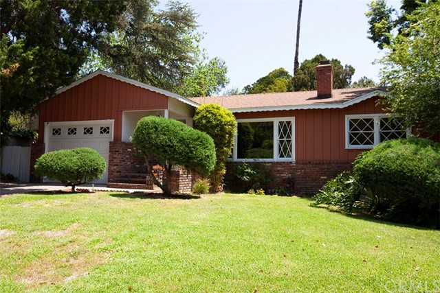 Come quick before this original 1960's cozy ranch home flys off the market. This charmer is nestled in the Pasadena Historic Higlands Landmark district on the border of Altadena and Pasadena.  The home was originally 3 bedrooms (and per assessor) and converted to 2 BR to have large kitchen.  This 2 BR 1 3/4 bath home features a fireplace with bookshelves in the living room.  The yard with brick BBQ is HUGE (9619 SF lot) with room for expansion of home and adding a pool. The big patio is ready for your large family gatherings and entertaining.  Original hardwood in home. The kitchen is updated with built in lighted hutch.  Some of the orignal diamond pane windows are still in home. The home features a newer roof and updated plumbing.   Quiet neighborhood except when Hollywood comes to call and film in this highly desirable neighborhood.