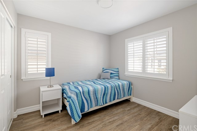 2nd bedroom with built in closet organizer