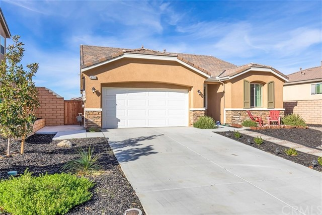Beautiful turnkey one-story home. Built in 2017, this 3bd/2ba home is practically new and ready to move in. You are going to love it! Open floorplan concept. Modern gorgeous kitchen. Supersized granite island with eating counter, stainless steel appliances and large walk-in pantry.Great room style family room with a corner set fireplace.Large master suite with private bathroom that includes double sinks, soaking tub, separate shower and walk-in closet. Upgraded features include tankless water heater, quiet cool whole house fan and solar panels from the builder. Ceiling fans throughout and upgraded raised panel doors including closet doors. Oversized laundry room with sink and a large open pantry area for great extra storage for all your supplies Two car garage with direct access to the home. Peek a boo view in back yard with concrete slab, turf and finished with wood chip landscaping for a clean fresh look. The details in this Woodside home make it top-notch. It is a must see!