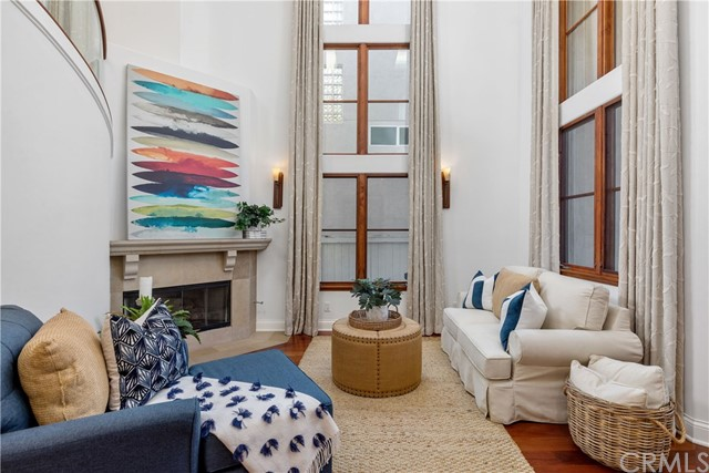 Beautiful front living room with soaring two story window.