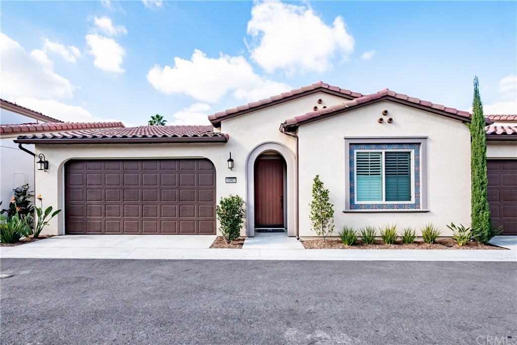Single level home with the perfect floorplan in the incredible active lifestyle community of Ovation at Flora Park - one occupant must be 55+. Highly upgraded and located on a private lot with California Room and nice little yard. Open floorplan with tall ceilings. Two well separated master suites each with large walk in closets and their own private baths with quartz counters & shower. There is also a powder room for guests. Main master suite has dual sinks, large curbless shower and enormous walk in closet and privacy toilet door. Beautiful wood look waterproof flooring throughout all traffic and living areas, recessed LED lighting with dimmers, dual pane windows, security system, high efficiency construction and materials. Island kitchen with white cabinets that have soft close doors and drawers, quartz slab counters, big walk in pantry, built-in 5 burner gas cooktop, stainless steel convection oven, microwave, dishwasher and matching refrigerator. Inside laundry room includes large capacity Maytag washer and dryer with drawer stands below them plus folding counter and tons of cabinetry. Lots of built-ins and extra storage. Attached direct access two car garage with remote controlled roll up garage door. Community is gated and has a clubhouse, pickleball courts, fitness center, group fitness studio, pool, spa, bocce ball, community fireplace & BBQ area, arts and crafts studio, walking paths, community events.