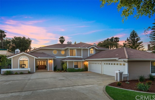 Updated and renovated custom home in Riverside's premier Alessandro Heights neighborhood. This traditional-style home is situated on a .59 acre lot with abundant hardscape, attached 4-car garage with deep bays, shaded RV parking, a detached RV garage/workshop (32x24) with 14' door, and more. The interior was refreshed just 2 years ago with luxury vinyl plank flooring downstairs, new interior and exterior paint, 2 new high efficiency HVAC units with new ducting, newly designed kitchen and bathrooms. The kitchen is light and bright with white shaker cabinets, quartz countertops, stainless steel appliances, walk-in pantry, large breakfast room and kitchen island. The kitchen opens to the family room with a wet bar, built-in cabinets and a fireplace. The living room and dining room have vaulted ceilings and are open to the foyer. Additionally, there are two downstairs bedrooms, one full bathroom and a separate powder room. Upstairs the primary suite is expansive with a separate sitting area or home office, balcony and views of the backyard, citrus trees and sunsets. The primary bathroom has a dual vanity, quartz countertops, walk-in closet, separate soaker tub and walk-in shower. The two guest suites on the second level share a bathroom with a tub in shower and dual vanities. The backyard is simply designed providing lots of options for recreational vehicle