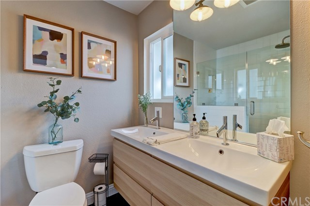 Private Bath with dual vanities and lot of light