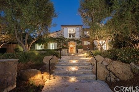 The romance and elegance of the French countryside are alive and well at this extraordinary white shuttered Provencal estate situated on over one-half acre in the exclusive golf preserve of Shady Canyon.  In this private cul-de-sac, find panoramic views of the golf course, canyon, and night lights.  Entertaining options abound for optimal indoor-outdoor living centered round fireplaces, private spa, pool, courtyards, and of course, stunning views.  Two levels of luxury living encompass six bedrooms, six baths, and powder room in approximately 7,000 square feet.  The spacious gourmet kitchen offers plenty of room to create culinary masterpieces.  The great room blends into the kitchen, with picturesque golf course vistas.  Sophistication and comfort join together in the amazing dining room, with its stone walls, barrel ceiling, and custom-built wine racks.  A temperature-controlled wine room is close to hand to ensure the ultimate in accessible entertaining.  The great room includes a full-service bar and seating area that opens seamlessly to an outdoor covered loggia, fireplace, and spa.  French doors escort you to he grounds of the estate, which feature a plethora of places to relax and enjoy the beautiful scenery. To view floor plan please see listing supplements.
