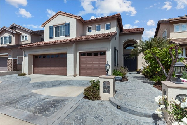 Discover serenity and privacy inside the gates of the exclusive Columbia Westmont community of Tustin Ranch. This gorgeous four bedroom, three bath home is located on a cul-de-sac and impresses with its high ceilings and abundance of natural light that illuminates the interior. Hone your cooking skills in the kitchen that has been newly remodeled featuring stainless steel appliances, white cabinets, granite countertops and center island, and access to the entertainer's paradise backyard. Upstairs, the large master suite is the perfect place to relax thanks to a soaking tub, walk-in closet, and dual sinks. This home showcases a highly sought-after location in the award-winning Tustin Unified School District and is only minutes to toll roads, the Tustin Market Place, Orchard Hills, Tustin Ranch Golf Course, and hiking and biking trails. Homeowners will enjoy living right in the heart of Orange County.